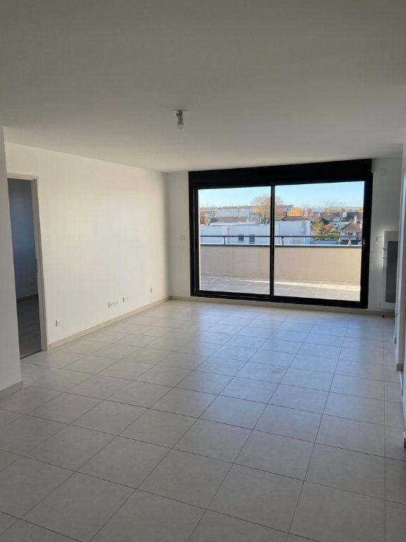 Appartement à vendre 3 66.3m2 à Reims vignette-1