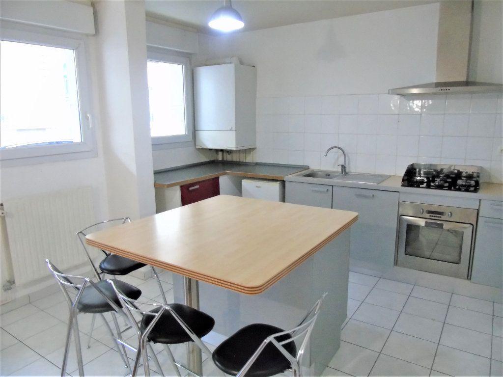 Appartement à vendre 4 75.2m2 à Reims vignette-2
