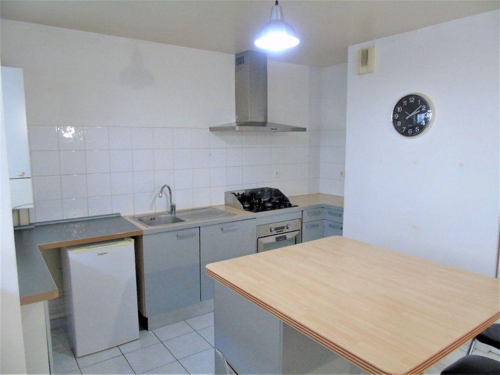 Appartement à vendre 4 75.2m2 à Reims vignette-3