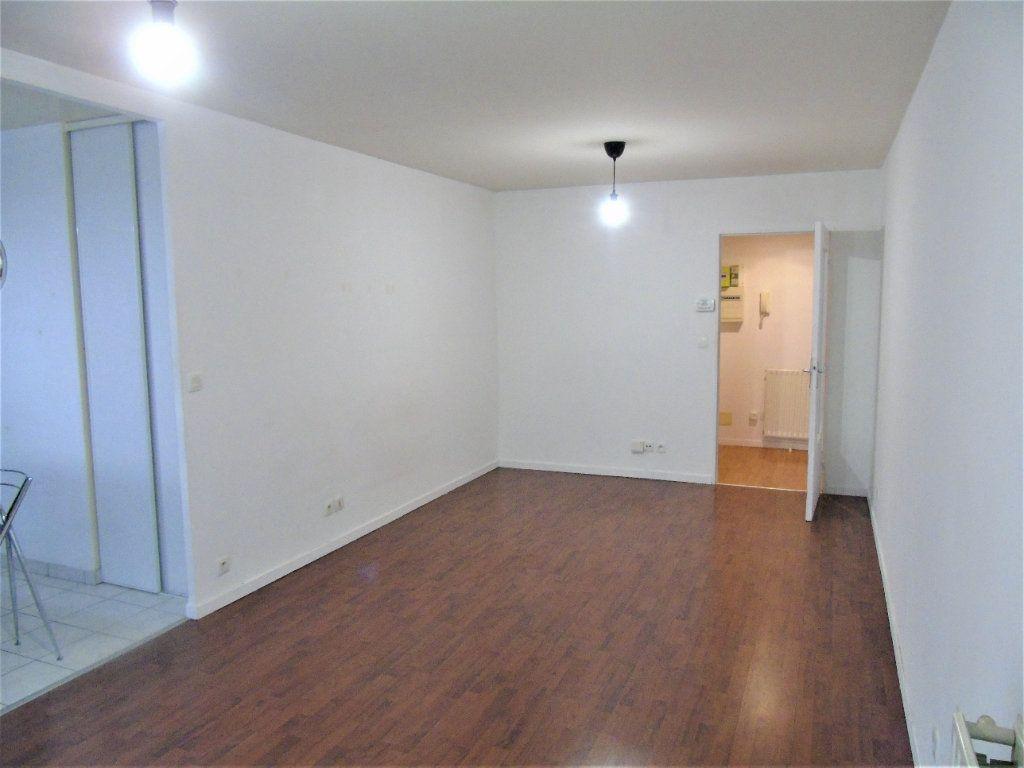 Appartement à vendre 4 75.2m2 à Reims vignette-4