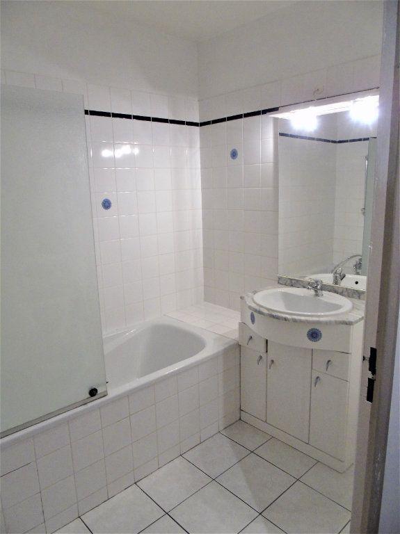 Appartement à vendre 4 75.2m2 à Reims vignette-11
