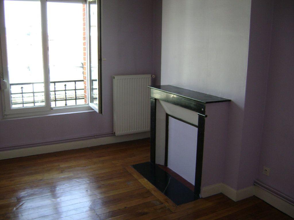 Appartement à vendre 3 54m2 à Reims vignette-1