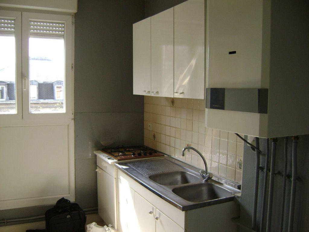 Appartement à vendre 3 54m2 à Reims vignette-2