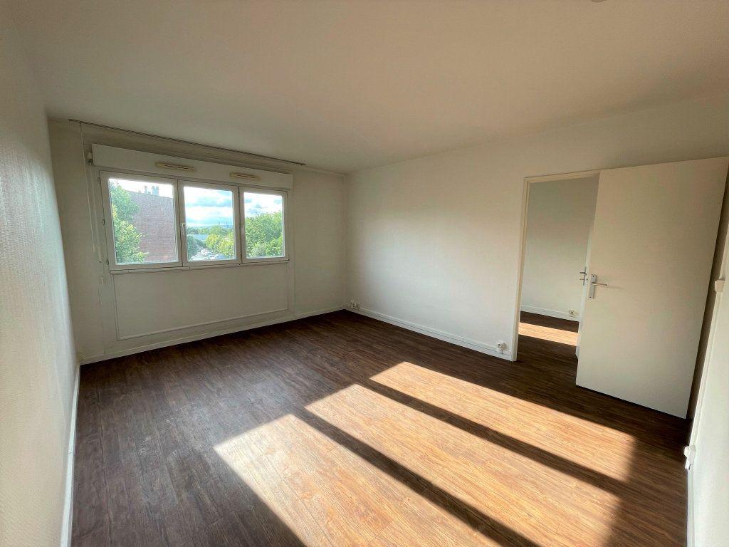 Appartement à louer 3 54.5m2 à Reims vignette-2