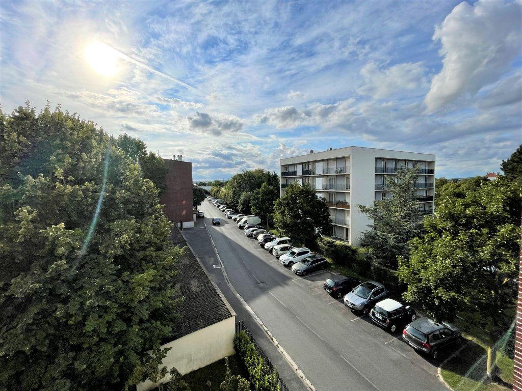 Appartement à louer 3 54.5m2 à Reims vignette-5