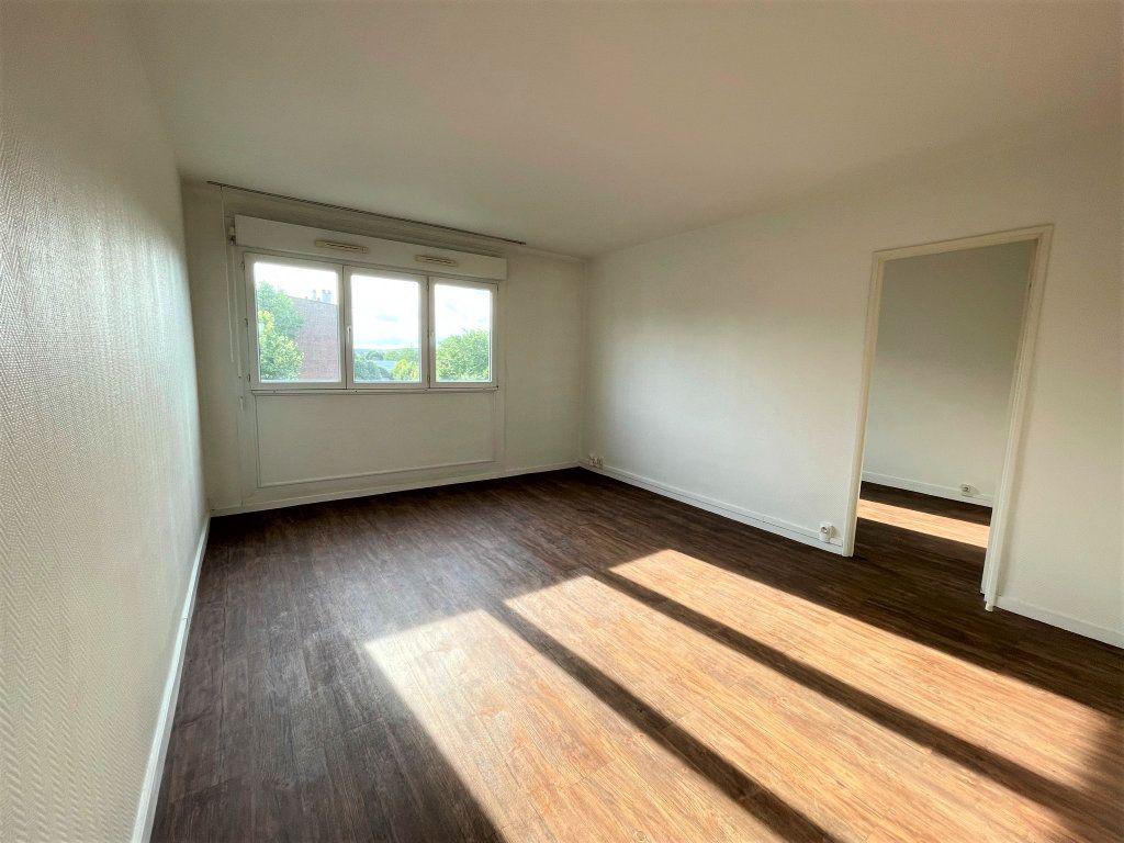 Appartement à louer 3 54.5m2 à Reims vignette-9