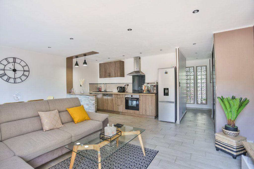 Appartement à vendre 3 65.11m2 à Mandelieu-la-Napoule vignette-1