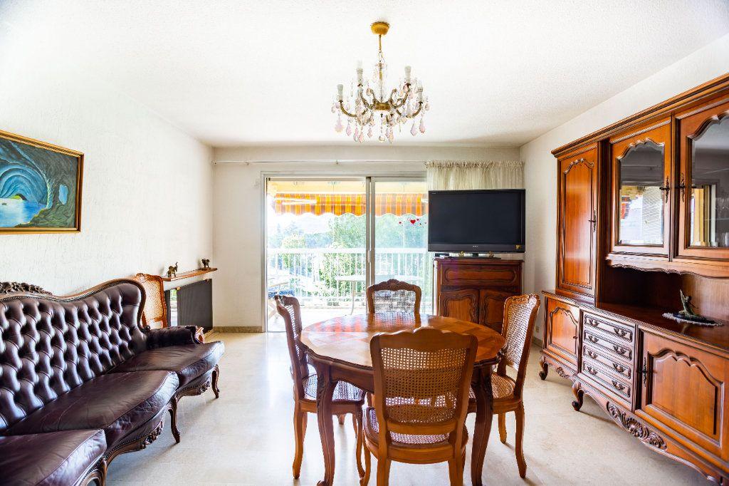 Appartement à vendre 3 69m2 à Mandelieu-la-Napoule vignette-2
