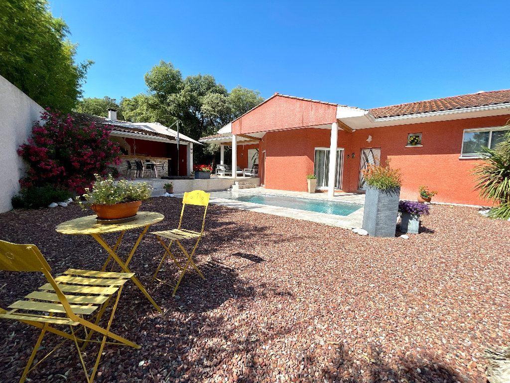 Maison à vendre 4 166.35m2 à Saint-Bauzille-de-Montmel vignette-1