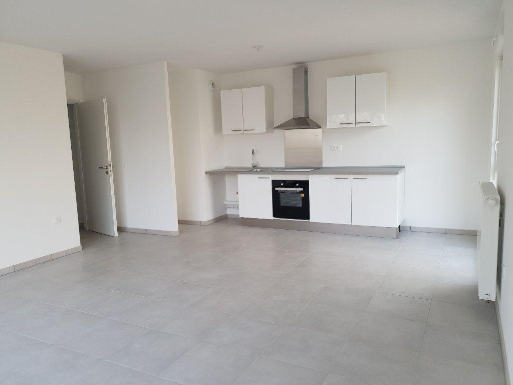 Appartement à louer 3 64.85m2 à Villers-lès-Nancy vignette-3
