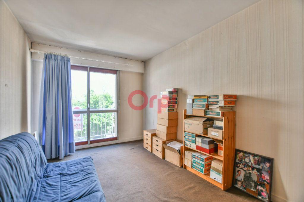 Appartement à vendre 5 105.5m2 à Paris 15 vignette-6