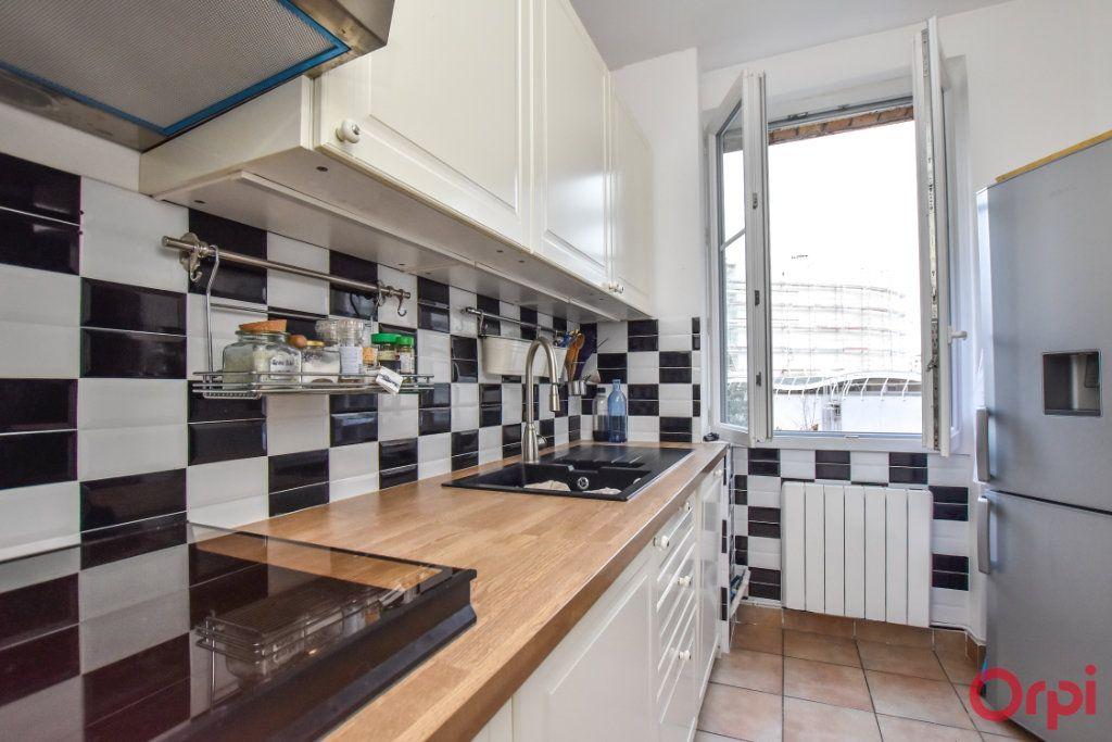 Appartement à vendre 2 48m2 à Paris 15 vignette-3