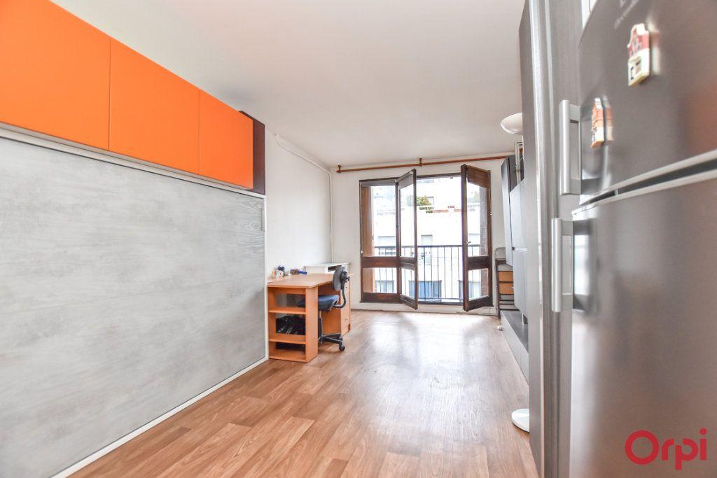 Appartement à louer 1 24.31m2 à Paris 15 vignette-2