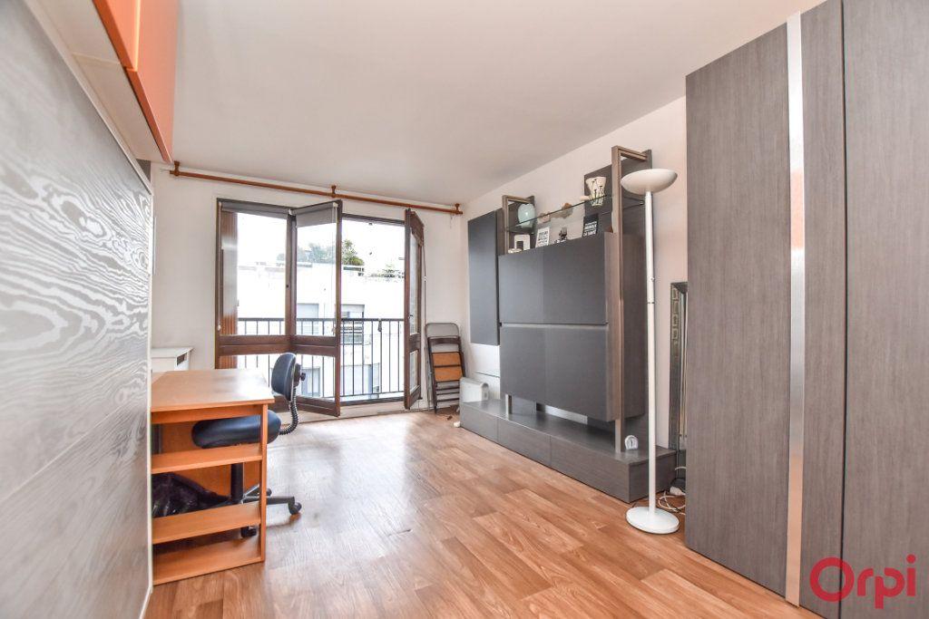 Appartement à louer 1 24.31m2 à Paris 15 vignette-5