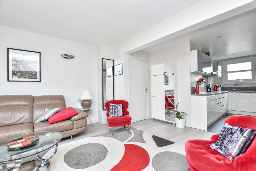 Appartement à vendre 3 62.55m2 à Paris 15 vignette-1