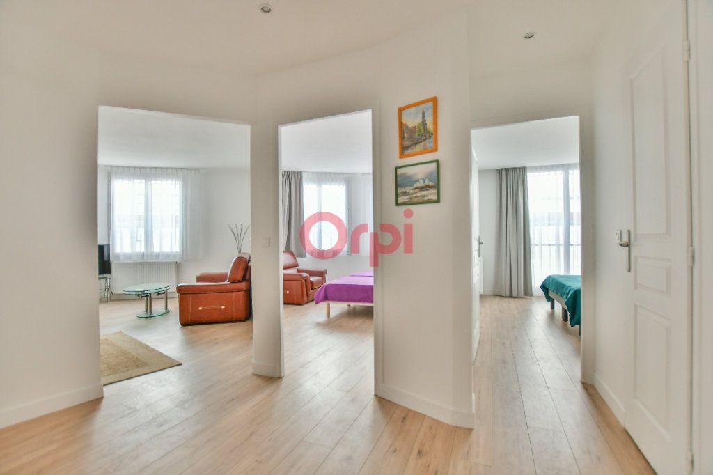 Appartement à vendre 3 67m2 à Paris 15 vignette-2