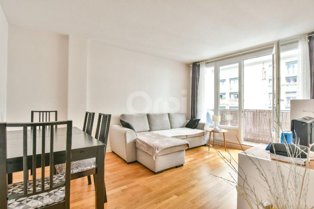 Appartement à louer 2 52m2 à Paris 15 vignette-2