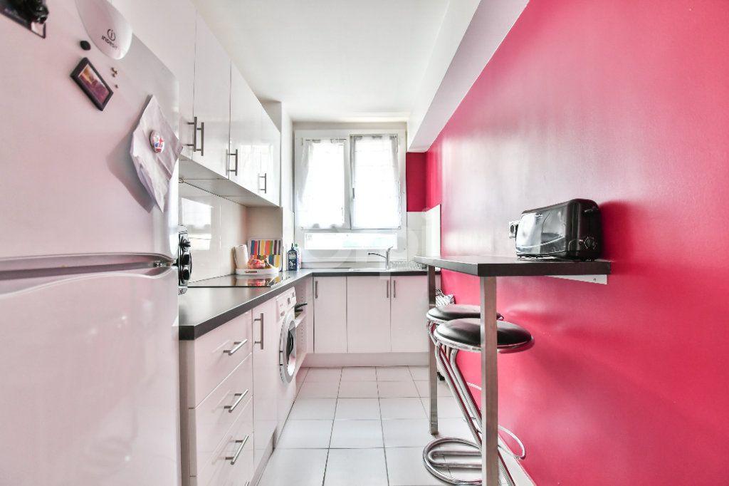 Appartement à louer 2 52m2 à Paris 15 vignette-3