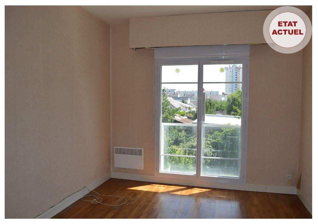 Appartement à vendre 3 65m2 à Saint-Pierre-des-Corps vignette-3