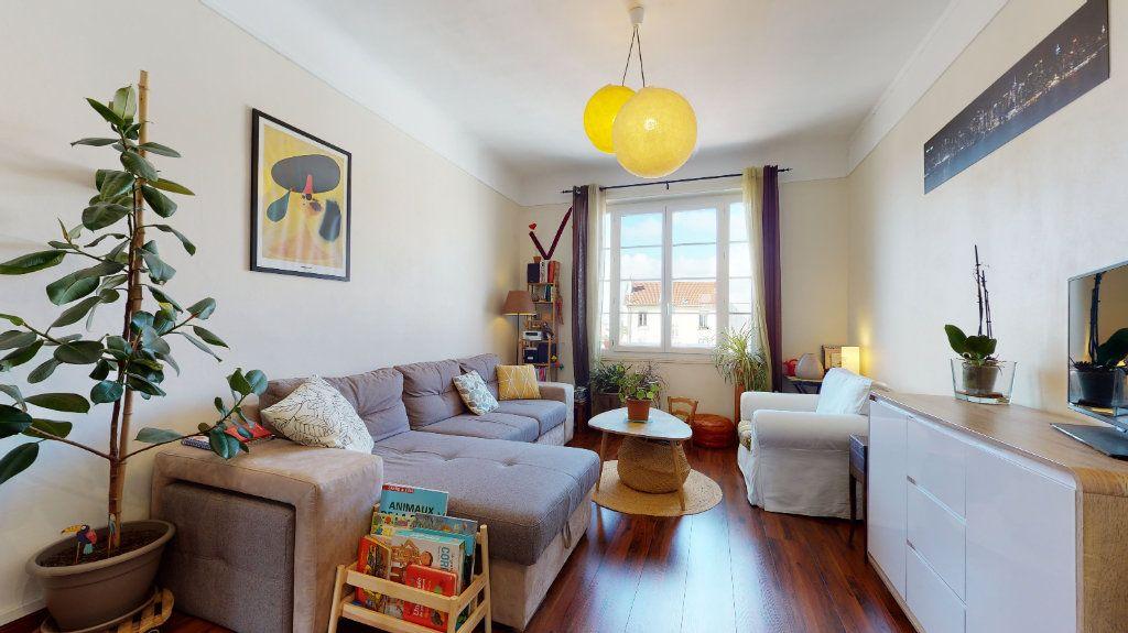 Appartement à vendre 3 77.59m2 à Lyon 7 vignette-2