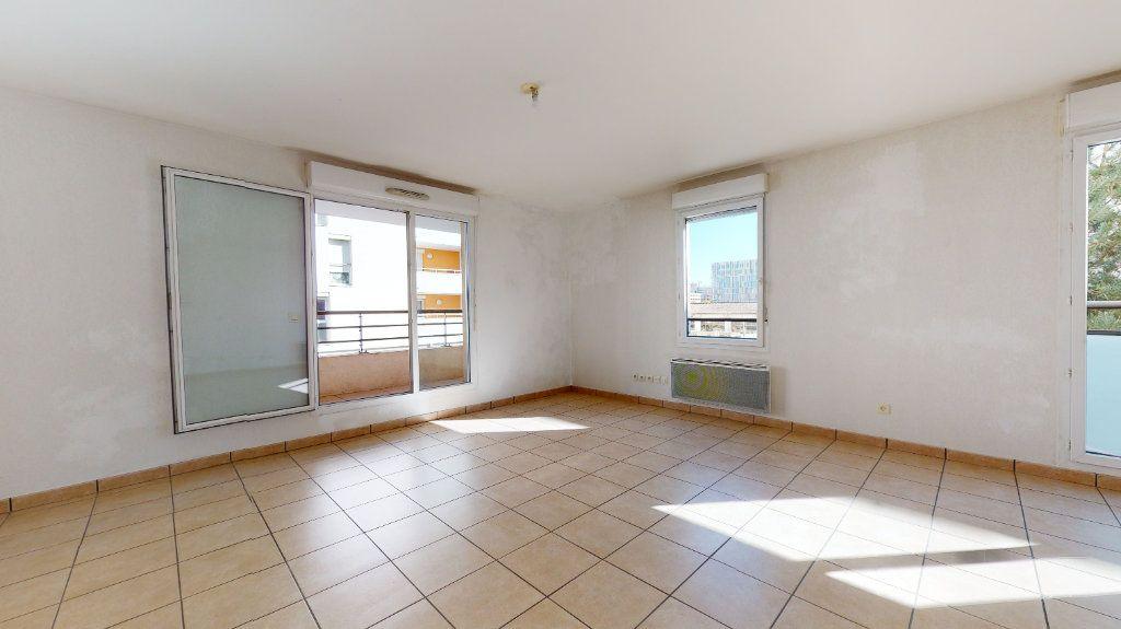 Appartement à vendre 3 61.22m2 à Lyon 7 vignette-3