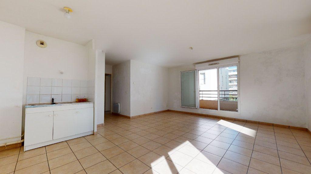 Appartement à vendre 3 61.22m2 à Lyon 7 vignette-4