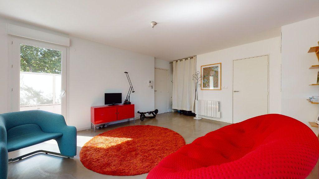 Appartement à vendre 3 63.8m2 à Lyon 7 vignette-2