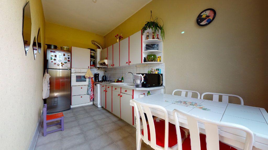 Appartement à vendre 5 140m2 à Lyon 4 vignette-4