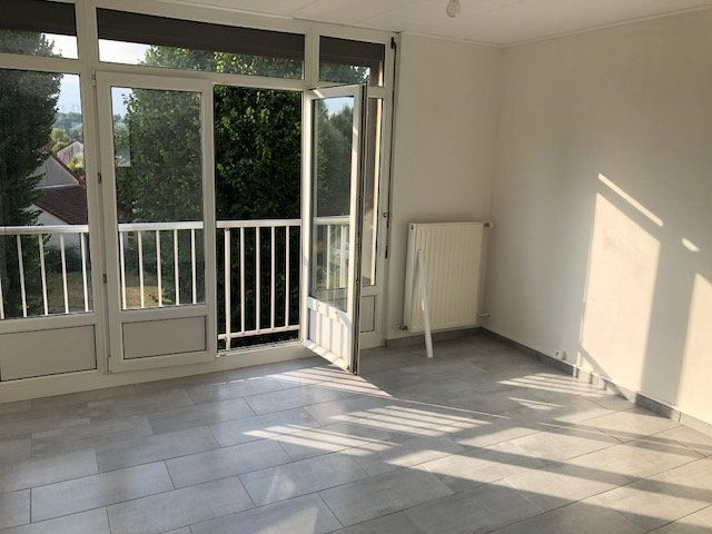 Appartement à louer 4 57.41m2 à Revigny-sur-Ornain vignette-2