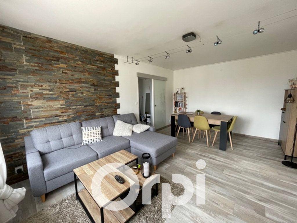 Appartement à louer 3 59.28m2 à Cormelles-le-Royal vignette-1