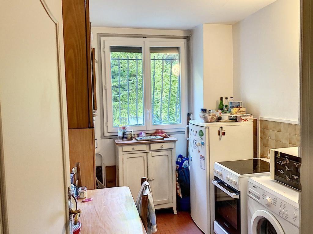 Appartement à vendre 3 62.1m2 à Paris 17 vignette-4