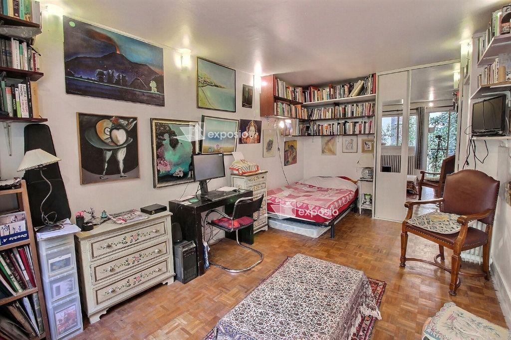 Appartement à vendre 1 26m2 à Paris 18 vignette-2