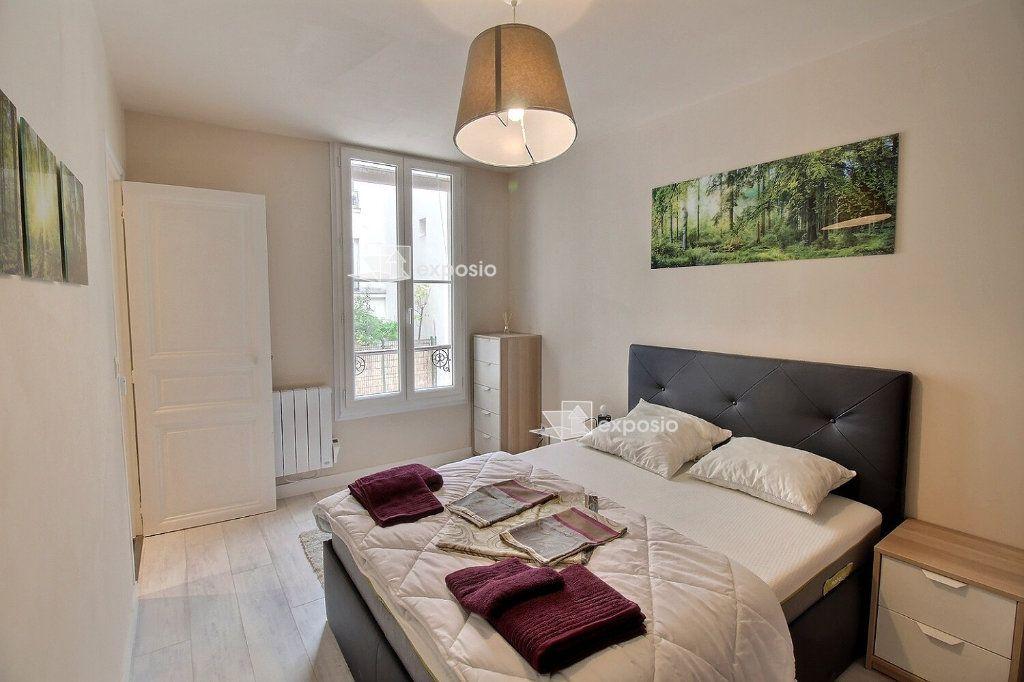 Appartement à louer 2 49m2 à Paris 18 vignette-8