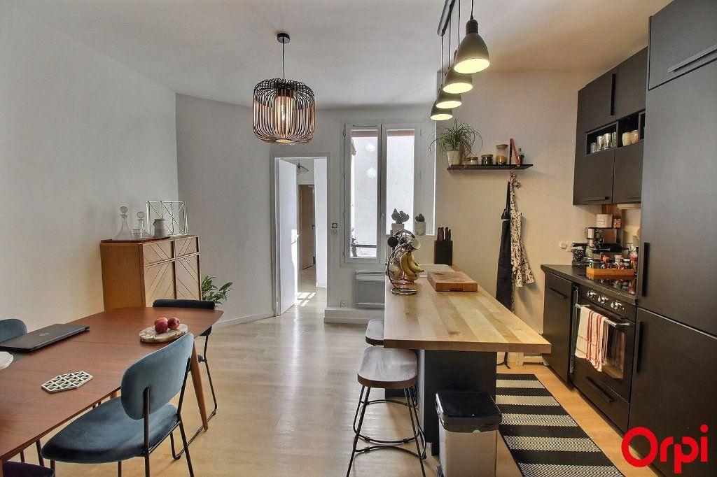 Appartement à vendre 3 47m2 à Paris 18 vignette-5
