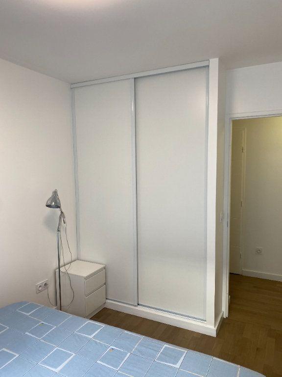 Appartement à louer 3 60m2 à Paris 18 vignette-8