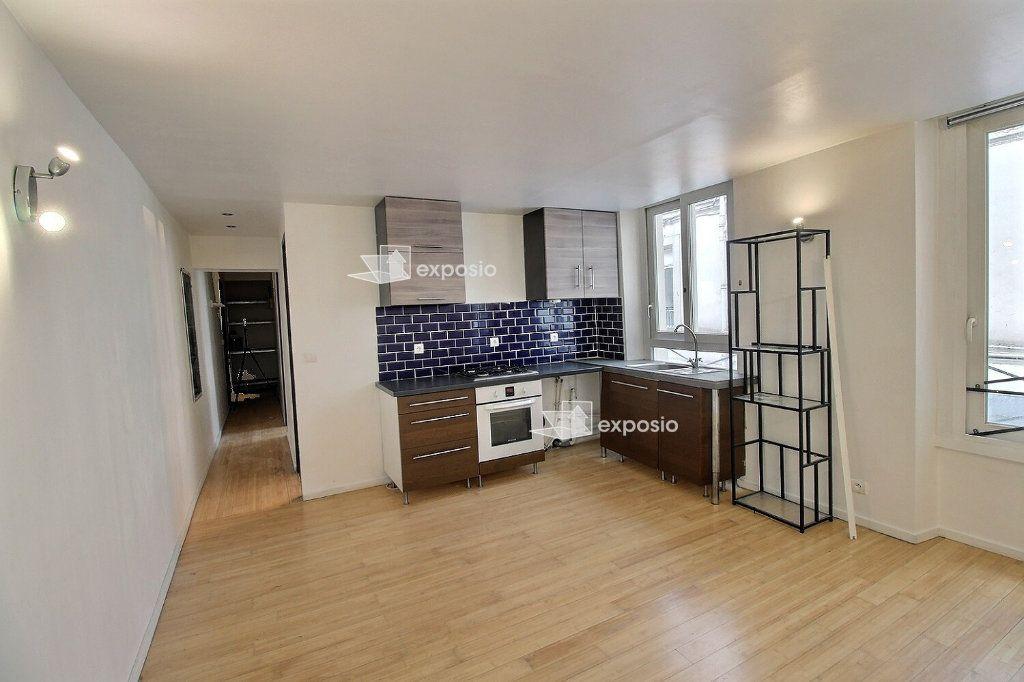 Appartement à vendre 2 40m2 à Paris 18 vignette-1