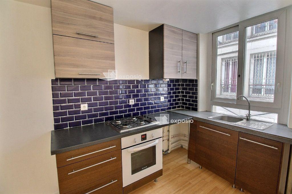 Appartement à vendre 2 40m2 à Paris 18 vignette-3