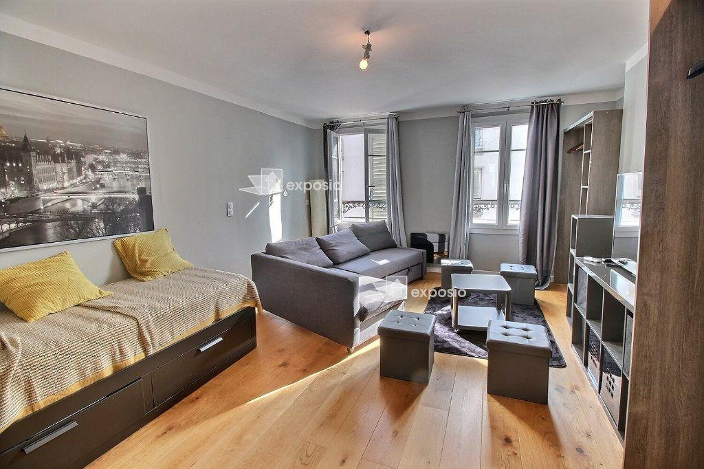 Appartement à louer 1 32.6m2 à Paris 17 vignette-1