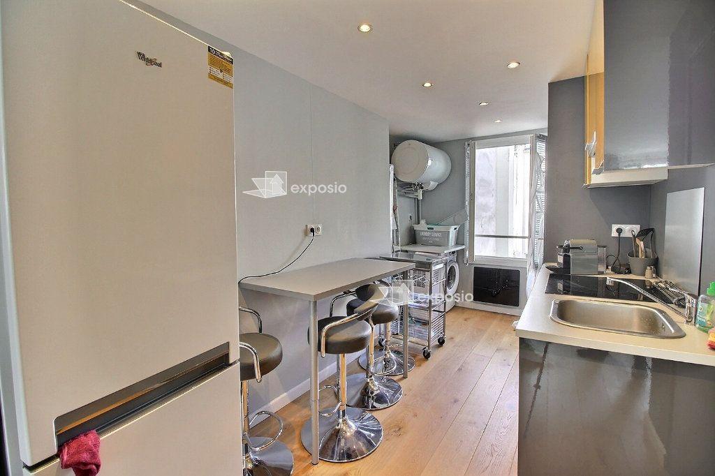 Appartement à louer 1 32.6m2 à Paris 17 vignette-3