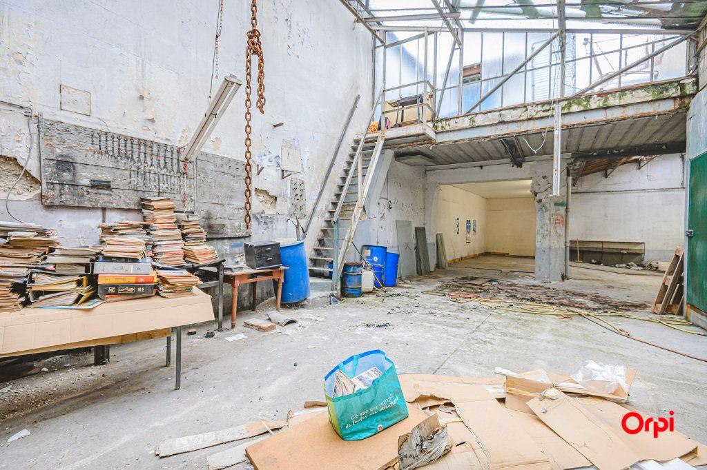 Appartement à vendre 1 310m2 à Reims vignette-4