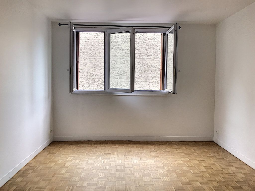 Appartement à vendre 3 54m2 à Paris 17 vignette-4