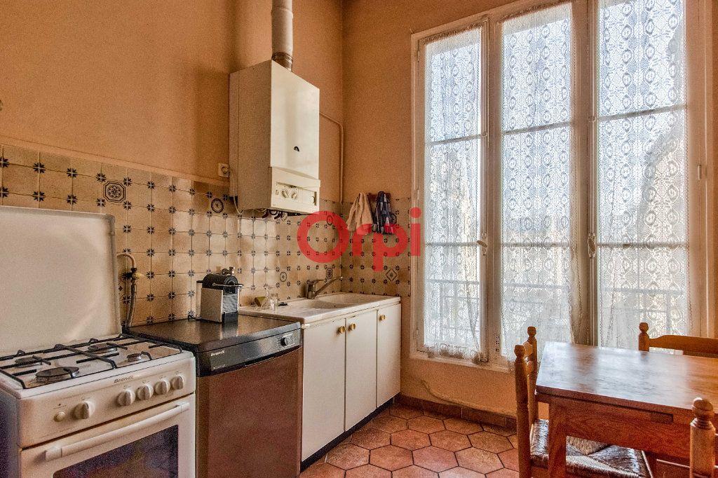 Appartement à vendre 4 127.45m2 à Paris 10 vignette-9