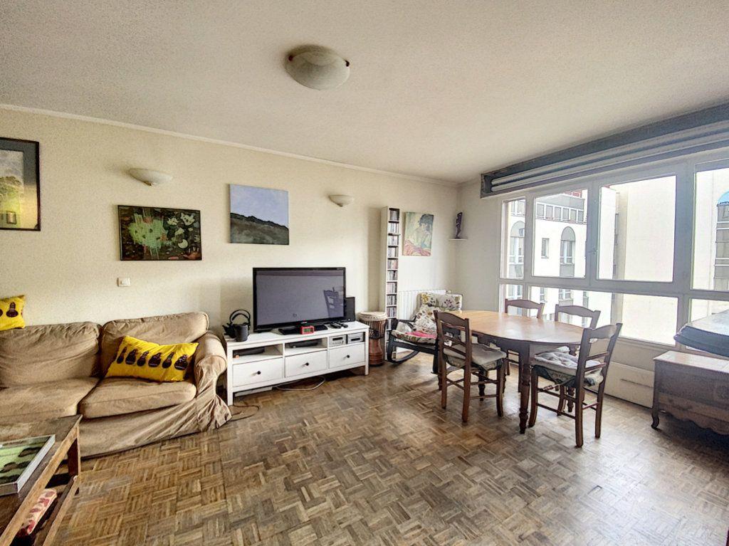 Appartement à vendre 4 82m2 à Paris 19 vignette-7