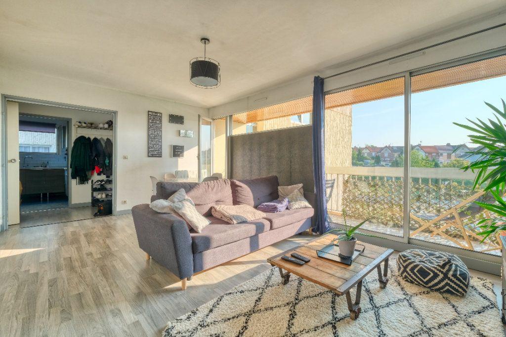 Appartement à vendre 3 69m2 à Saint-Quentin vignette-1