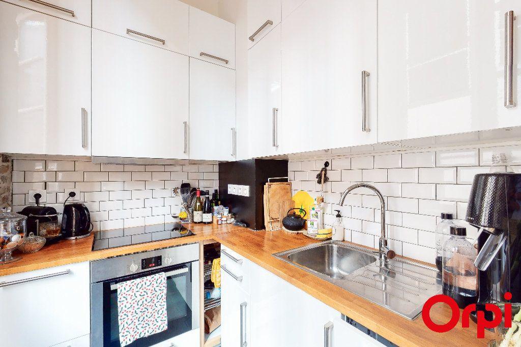 Appartement à vendre 2 54.9m2 à Lyon 1 vignette-3