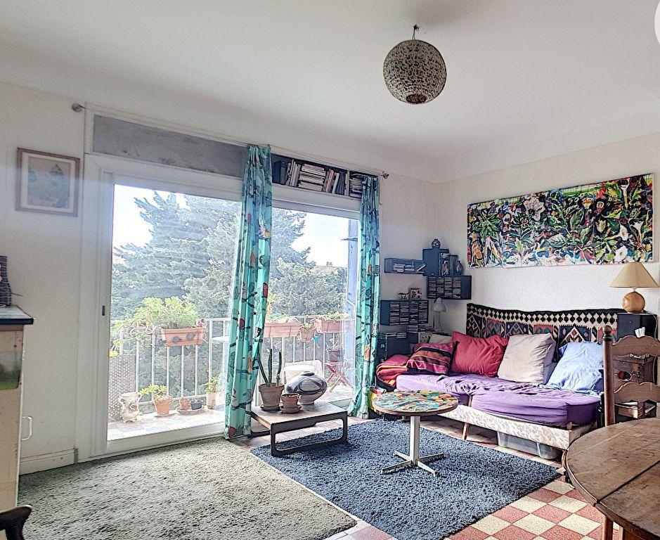 Appartement à vendre 4 76m2 à Arles vignette-2