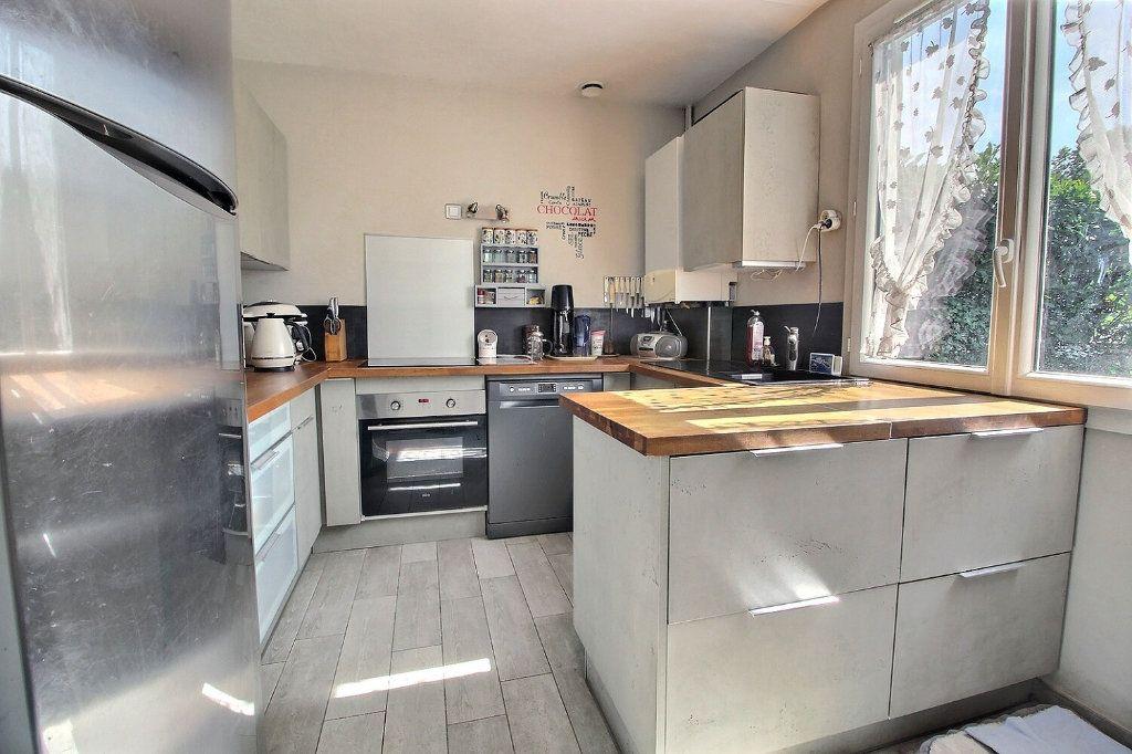 Maison à vendre 6 118m2 à Montigny-le-Bretonneux vignette-5