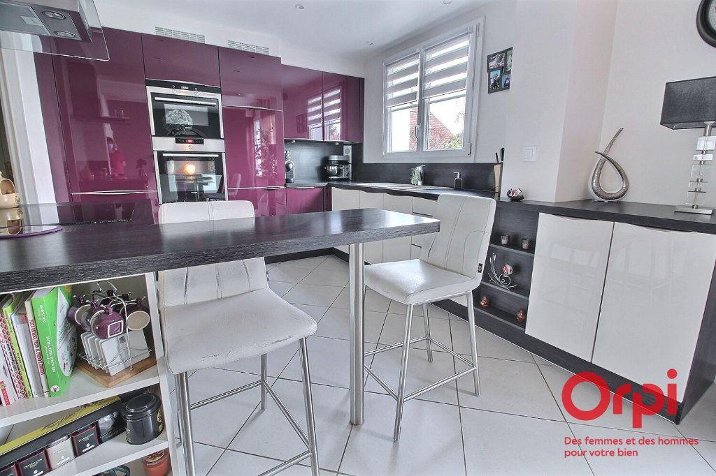 Maison à vendre 7 121.45m2 à Montigny-le-Bretonneux vignette-5