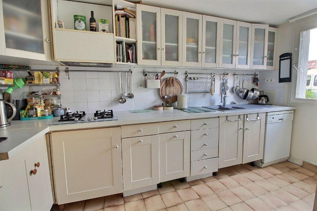 Maison à vendre 6 125m2 à Montigny-le-Bretonneux vignette-3