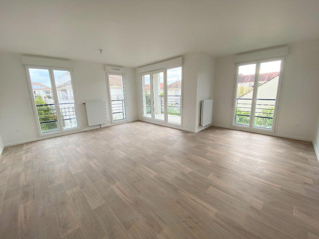 Appartement à vendre 3 66.79m2 à Montigny-le-Bretonneux vignette-4